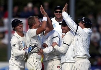 New Zealand's Wagner celebrates with team mates after dismissing England's Pietersen for a duck during the second day of the first test at the University Oval in Dunedin